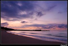 Sunset @ SVB (Cameno) Tags: sunset sea españa beach water clouds d50 atardecer mar spain agua nikon purple wave playa tokina shore nubes puestadesol 1224mm santander ola cantabria orilla morado sanvicentedelabarquera