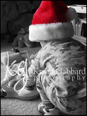 christmas hat and toys (Krista Gabbard) Tags: christmas boy portrait holiday toys toddler december kentucky candid seasonal louisville santahat pajamas selectivecolor