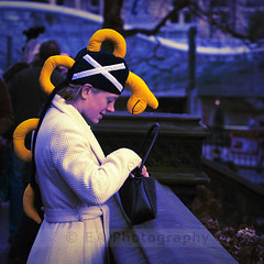 Nosey Nessie (Scottish Snapper) Tags: people woman edinburgh candid christmaseve lochnessmonster nessie wintermarket comedyhat