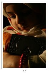 HUGGING QURAN (mehmetakifguler) Tags: girl scarf child islam hijab kerim quran qoran slam kuran barts kuran