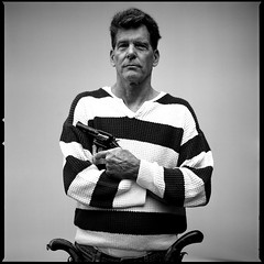 Chuck is my Father (cole emde) Tags: portrait blackandwhite bw man film monochrome mediumformat sweater gun dad vet monochromatic hasselblad human weapon guns grayscale handgun usairforce greyscale firearm 501cm smithwesson manwithgun smithandwessonmodel10