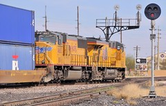 Union Pacific westbound freight train, with radio-controlled helper locomotives, entering Tucson, Arizona, March 20, 2008 (Ivan S. Abrams) Tags: california arizona up nebraska tucson nevada ivan eisenbahn trains sierra amtrak sp fresno getty unionpacific freighttrains reno nikkor abrams railways nikondigital tehachapi trainspotting locomotives cajon gettyimages railroads southernpacific smrgsbord tucsonarizona uprr pfe cnw unionpacificrailroad ferromex chicagoandnorthwestern railfans 12608 sprr sunsetroute americantrains unionpacificrailway pacificfruitexpress onlythebestare ivansabrams trainplanepro arizonatrains southwesterntrains nikond300 pimacountyarizona safyan arizonabar spdaylight arizonaphotographers ivanabrams cochisecountyarizona westerntrains westernustrains railroadsofarizona gettyimagesandtheflickrcollection copyrightivansabramsallrightsreservedunauthorizeduseofthisimageisprohibited tucson3985gmailcom ivansafyanabrams arizonalawyers statebarofarizona californialawyers califiorniazephyr copyrightivansafyanabrams2009allrightsreservedunauthorizeduseprohibitedbylawpropertyofivansafyanabrams unauthorizeduseconstitutestheft thisphotographwasmadebyivansafyanabramswhoretainsallrightstheretoc2009ivansafyanabrams abramsandmcdanielinternationallawandeconomicdiplomacy ivansabramsarizonaattorney ivansabramsbauniversityofpittsburghjduniversityofpittsburghllmuniversityofarizonainternationallawyer