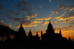 Clouds in fire - Bagan - Myanmar (PascalBo) Tags: silhouette architecture clouds sunrise landscape outdoors temple pagoda nikon asia southeastasia d70 burma buddhism myanmar asie nuages paysage pagan bagan leverdesoleil bouddhisme pagode birmanie 123faves asiedusudest lpmorning pascalboegli