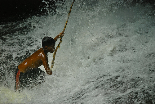 Boy playing in a waterfall at Kbal Spean, Angkor Wat