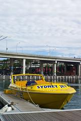 Sydney Jet Boat: Darling Harbour, Sydney (Craig Jewell Photography) Tags: bridge iso100 boat cloudy harbour flag banner jet sydney overcast australia flags pyrmont darling spunout sydneyjet 1125sec pentaxk10d cpjsm craigjewellphotography