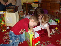 Big kids helping Fiona open presents (superlori) Tags: birthday party fiona