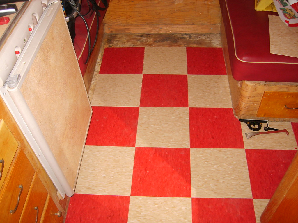 Stage three, tiles laid out and being cut to size.