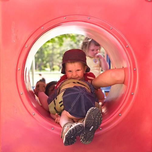 Three boys in a tunnel
