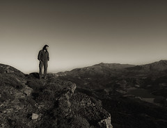 Man on the silver mountain (Theophilos) Tags: blackandwhite bw lake man mountains landscape view greece