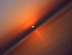 The Rising (~~[(QTR)]~Mubarak~) Tags: sea sky orange sun water sunrise purple horizon doha qatar qtr iwaswithbujasim miskeenhehadtostayuplate mubarakqtr mubarakqatar