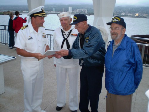 3 survivors of the USS Oklahoma and the current commander of Naval Station Pearl Harbor