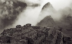 Machu Picchu in the Mist (sixbysixtasy) Tags: city travel bw cloud mist mountains film peru southamerica fog inca forest lost ruins machupicchu nikkormat