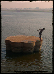 Diving in the Field of Fulfillment (designldg) Tags: india man water architecture river varanasi ganga ganges ghats benaras uttarpradesh  indiasong