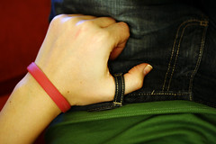 Day 105 - Holding On (nataliej) Tags: portrait me self lounge jeans bracelet thumb grip 2008 wristband hold day105 365days