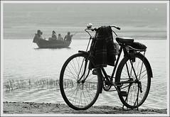 Great inventions [..Manikganj, Bangladesh..] (Catch the dream) Tags: bw bicycle rural river boat blackwhite peace village bongo transport calm serene riverbank bengal bangladesh bangla bengali bangladeshi bangali platinumphoto catchthedream gettyimagesbangladeshq2