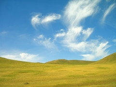 There (The Wandering Angel) Tags: blue sky mountains green nature beauty clouds country hills mongolia creativecommons vistas inspirational spaces vast aplusphoto platinumheartaward zhuunkharaa