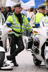 Easy rider (RobC'ham) Tags: blue london canon square eos lights cops burma trafalgar police motorbike cop bmw motorcycle protests leaning coppers policeman protestors 400d