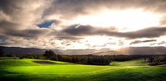 18th green at Le Portage Golf Course, Cape Breton (gallow_chris) Tags: travel canada tourism angel clouds forest sunrise golf nikon novascotia d2x course capebreton greenmountains raysoflight 1735mm chrisgallow nikoncapturenx chrisgallow leportage breaksun dramababy brillantlight
