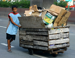 boy pushing a cart2 (_gem_) Tags: street wood city boy urban outdoors wooden paint afternoon candid philippines wheels cardboard manila carton daytime boxes cart recycling quezoncity pushing paintcan metromanila recyclables boysen woodencart