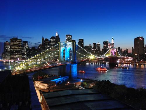 Manhattan skyline and lit brooklyn bridge nyc