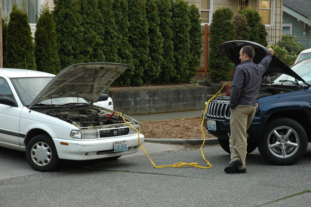 Man at ease, recharging a dead battery, by Wonderlane, on Flickr