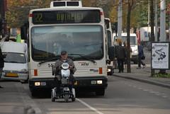 Hurry up! (FaceMePLS) Tags: bus nederland thenetherlands streetphotography denhaag publictransport autobus openbaarvervoer candidphotography htm scootmobiel stadsbus nikond200 straatfotografie peopleinthestreet facemepls abigfave mensenindestraat