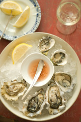 sunkissed oysters (mwhammer) Tags: blue red white cold color texture ice yellow lemon europe raw display vibrant champagne vivid fresh explore crisp multiples olympia seafood oysters bowls prosecco propstyling mignonette foodstyling melinahammer malpaque