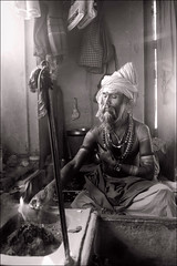 Yog - Benares (Elishams) Tags: portrait blackandwhite bw india fire indian traditional faith religion pray culture varanasi yogi puja sacrifice sadhu banaras benares northindia uttarpradesh  bhagavadgita hawan indedunord offrande nagababa ajaadpuri