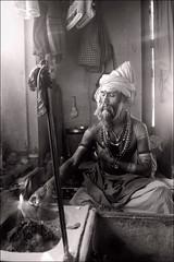 Yog - Benares (Elishams) Tags: portrait blackandwhite bw india fire indian traditional faith religion pray culture varanasi yogi puja sacrifice sadhu banaras benares northindia uttarpradesh  bhagavadgita hawan indedunord offrande nagababa ajaadpuri