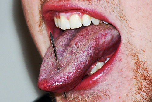 an argument in facor of tongue piercing I object to the tongue because i'm very keen on people talking clearly and  accurately and the tongue-piercing obscures the sound of the vowels.