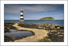 Penmon Lighthouse and Puffin Island (-terry-) Tags: sea sky cloud lighthouse wales island rocks flickr explore anglesey penmon flickrexplore puffinisland seeninexplore penmonlighthouse