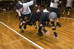 Harm City Homicide vs. New York Shock Exchange (epmd_derby) Tags: rollerderby championshipbout charmcityrollergirls mobtownmods nightterrors speedregime junkyarddolls puttyhillskateland harmcityhomicide newyorkshockexchange