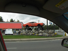 General Lee with monster truck tires on a pile of rocks (Awkward Boy Hero) Tags: oregon truck dukesofhazzard gresham generallee pileofrocks somewhereinoregon monstertrucktires awkwardboyhero