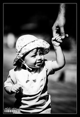 Come with me .. (Khalid AlHaqqan) Tags: baby white black girl hat canon daddy 350d rebel xt blackwhite kid dad child zoom kuwait khalid 100400mm hold kuwson alhaqqan