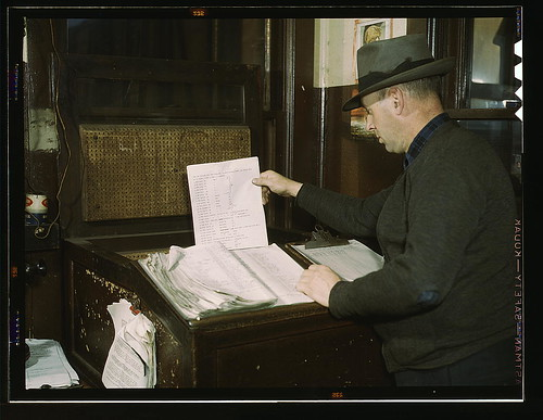 Switch lists coming in by teletype to the hump office at a Chicago and Northwestern railroad yard, Chicago, Ill. (LOC)