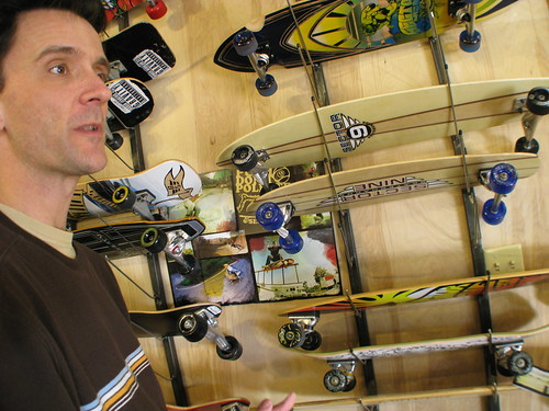 Jamey checks out skateboards at a skateboard shop in Pensacola, Florida, USA