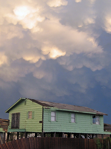 Green house and roiling sky