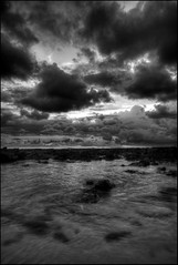 At The Seaside (Reto Togni Pogliorini) Tags: ocean sunset sky blackandwhite bw beach water evening reef clowds pazific