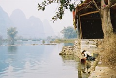 Woman washing clothes in the Li RIver (dadoll) Tags: china international yangshou southernchina southwestchina
