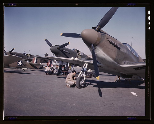 "Warbird picture - P-51 (""Mustang"") fighter planes being prepared for test flight at the field of the North American Aviation, Inc., plant in Inglewood, Calif. (LOC)"