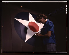 "A candid view of one of the women workers touching up the U.S. Army Air Forces insignia on the side of the fuselage of a ""Vengeance"" dive bomber manufactured at Vultee's Nashville division, Tennessee  (LOC) (The Library of Congress) Tags: red woman usa industry america plane painting circle airplane star us women war nashville tennessee military unitedstatesofamerica wwii brush slidefilm worldwarii painter transparency ww2 4x5 lf libraryofcongress february insignia bomber largeformat worldwar2 1943 wartime transparencies vengeance manufacturing nashvilletn divebomber workforce vultee february1943 davidsoncounty wareffort evintage xmlns:dc=httppurlorgdcelements11 awomanstouch dc:identifier=httphdllocgovlocpnpfsac1a35370 alfredtpalmer vulteeaircraftincorporated alfredpalmer"