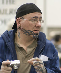 Tattoos (slambo_42) Tags: guy art wisconsin ink person weird dof body piercing tattoos madison wi tats
