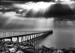 Coastal Bridge - Kuwait (khalid almasoud) Tags: bridge sea art clouds work dark coast photo scary rocks day photographer cloudy group photographers center kuwait  khalid fury natures between voluntary  a  almasoud   thebestofday gnneniyisi mozaiek