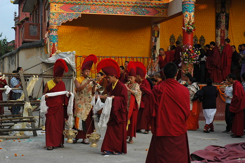 The Band of Buddhist monks, accompanying His Holiness Jigdal Dagchen Sakya, son and grandson to the monastery after the Long Life blessing which lasted all day, Tharlam Monastery of Tibetan Buddhism, stage, Boudha, Kathmandu, Nepal