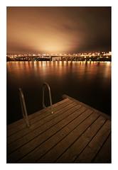 Lilla Essingen By Night III (Calle Artmark) Tags: city longexposure bridge sky water skyline lights sweden stockholm jetty later sigma1020mm canoneos400d callehglund chiiron hocal