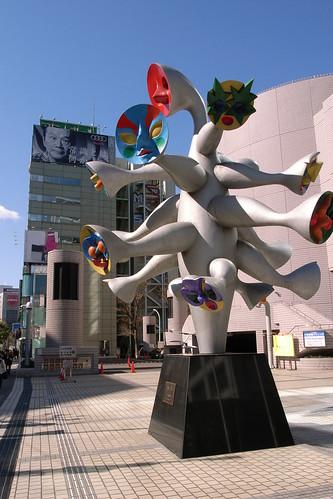 Okamoto Taro looks his art