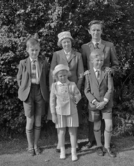 The Family - 1962 (opobs) Tags: family boy summer blackandwhite bw girl grass childhood socks shirt southwales wales pose children shoes sister brother sandals father mother tie curls suit hedge teenager shorts 1960s bridgend shorttrousers mikestokes michaelstokes opobs