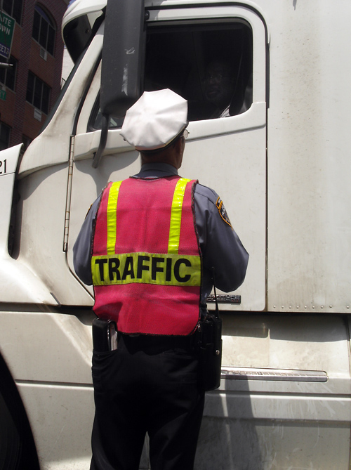 traffic cop talks to truck driver, Manhattan, NYC