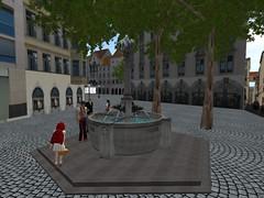 rotkappchenbrunnen mit rotkäppchen