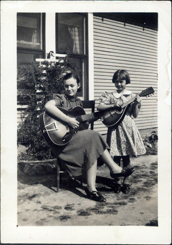 Two Girls with Guitar and Mandolin